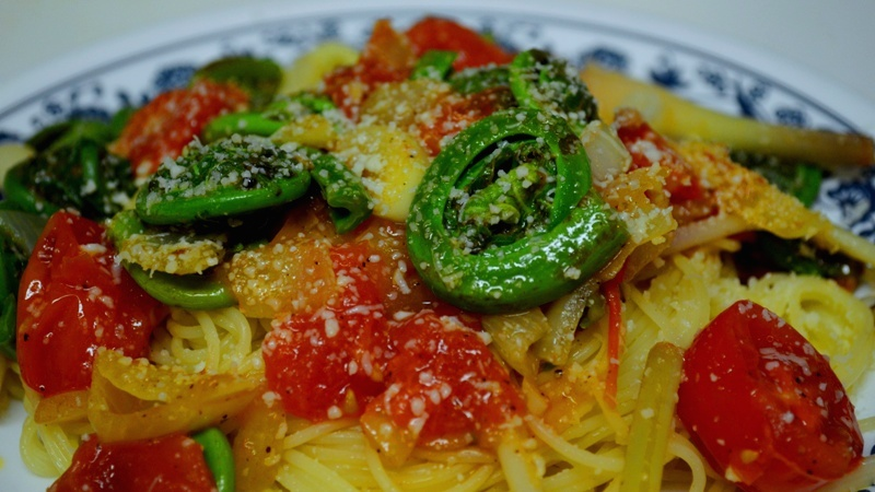 Sauteed Fiddleheads and Cherry Tomatoes over Angel Hair Pasta