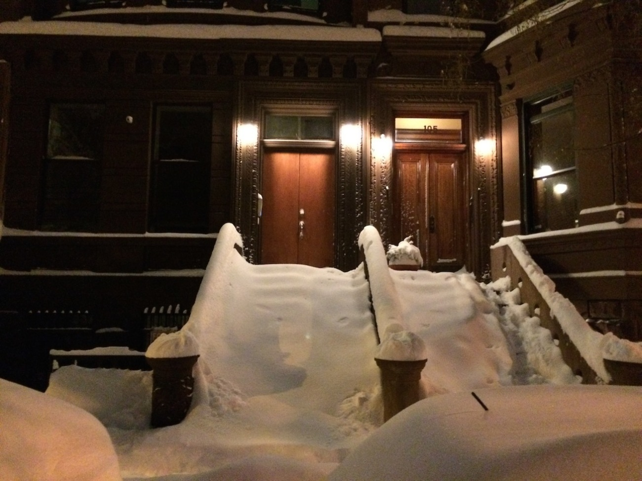 Snow Covered Brownstone Stairs